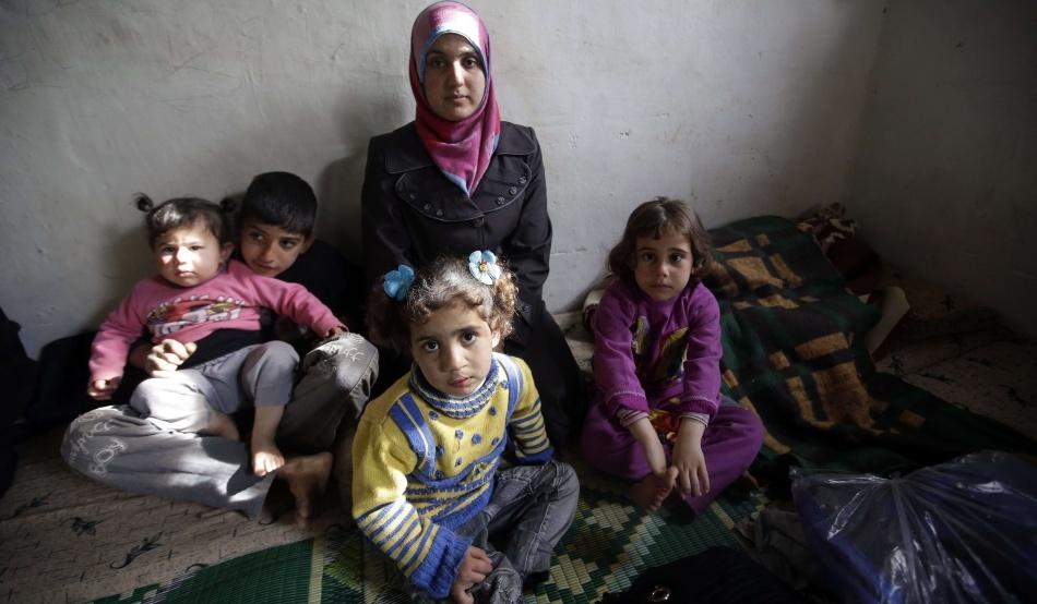 Familie de refugiaţi sirieni