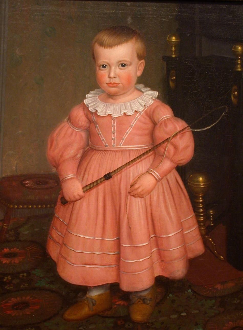 """""""Băieţaş cu bici"""", şcoala americană, cca. 1840. După cum se pare, nu era câtuşi de puţin nepotrivită, la acea epocă, îmbrăcarea unui băieţel  cu o rochiţă roz."""