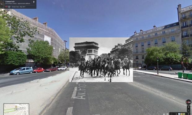 Soldaţi germani trec pe sub Arcul de Triumf şi mărşăluiesc pe Avenue Foch