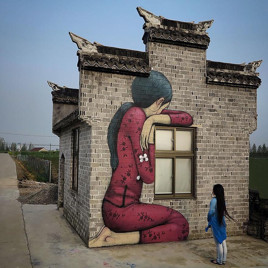 Artistul franceză tranformă străzile şi clădirile lumii în opere de artă. FOTO